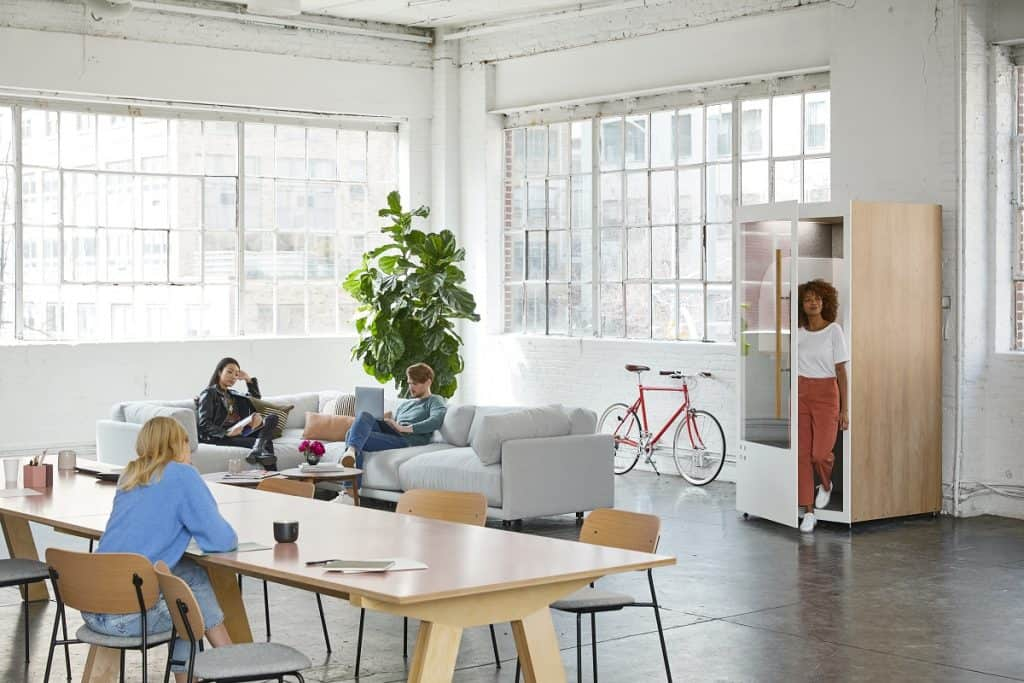 employees sitting in a wide office