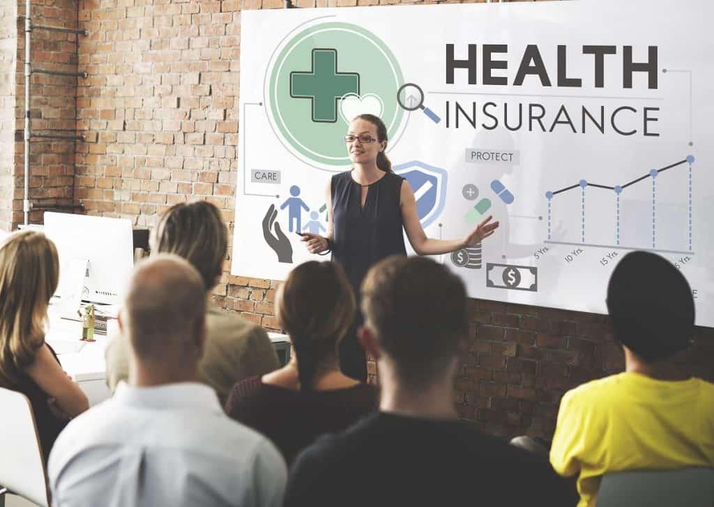 Office speaker talking about health insurance