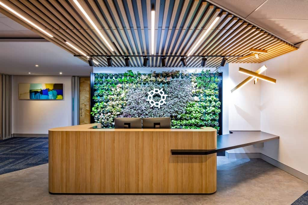 Reception desk with plant wall in the future workplace